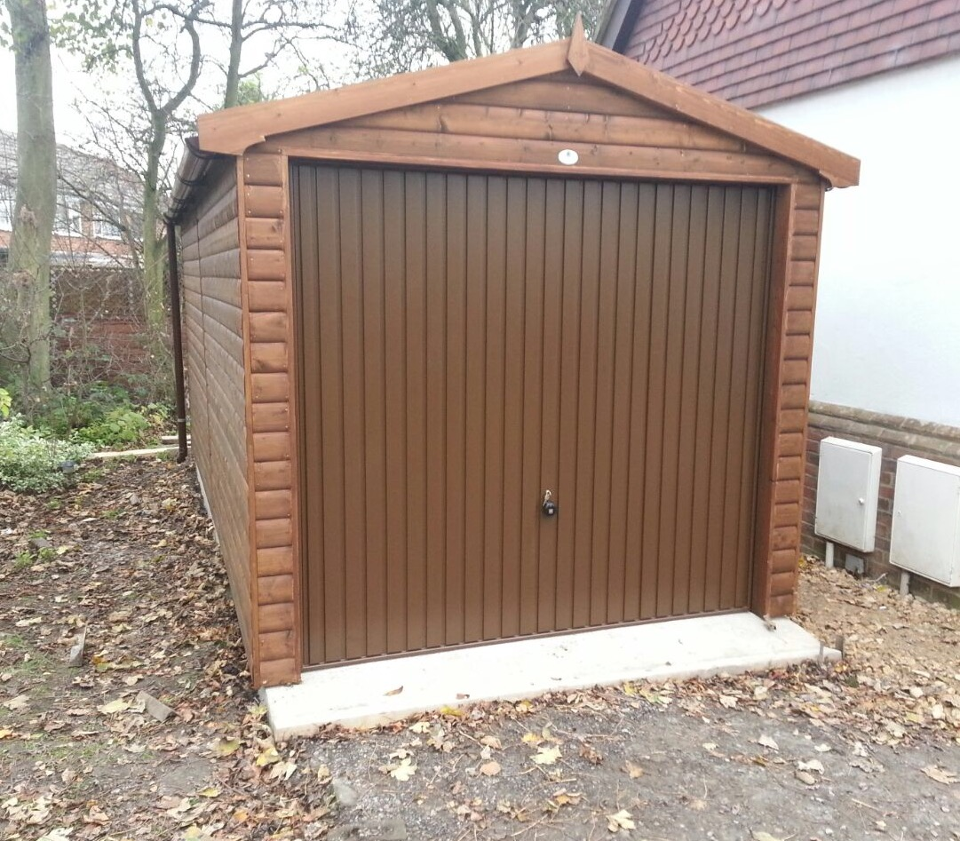 timber garages wooden garages timber buildings browns garden single garage 4 8m long x 2 4m wide finished in dark oak van dyke brown roof and with the option of a brown up and over