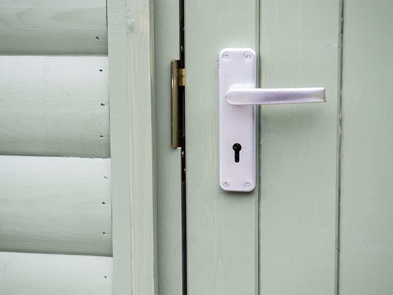 Suffolk framed ledged and braced door incorporating a 3 lever mortice lock latch and satin anodized furniture.