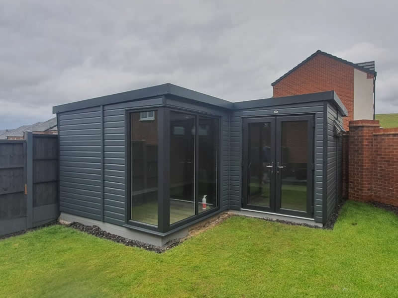 Manhattan L shaped home office/ gym in slate grey 5m x 5m.