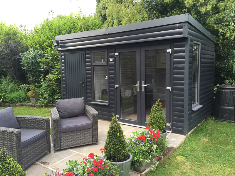 Garden Room With Store attached to the left with french doors and painted anthracite