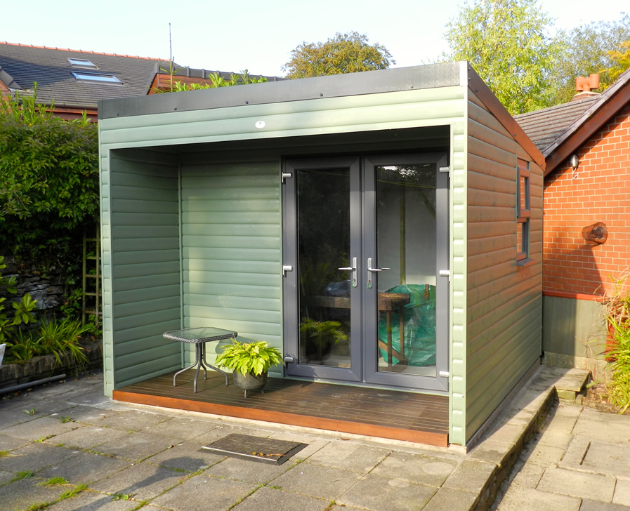 Garden room with covered area to the front of the building and decking