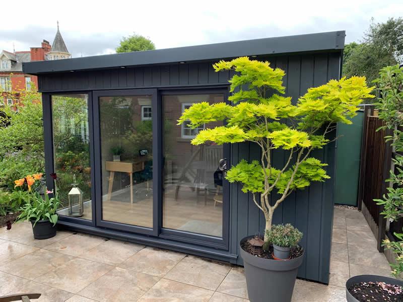 Manhattan garden room in slate grey with optional glazed corner 4m x 3m