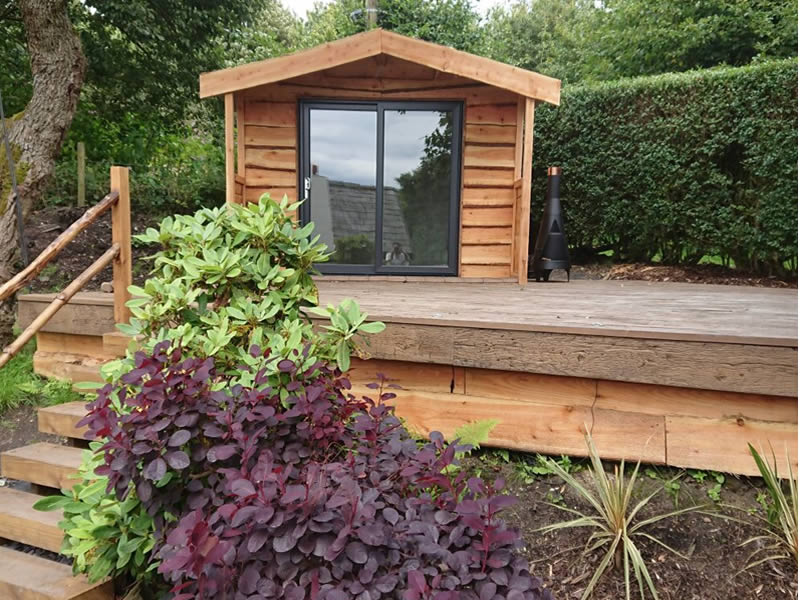 """Apex roof """"By Design"""" garden office finished with Yorkshire larch lap"""