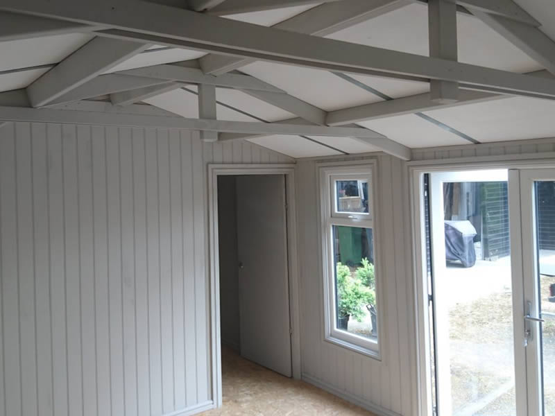 Internals clad in MDF vertical board fitted to an apex roof Pembroke office.