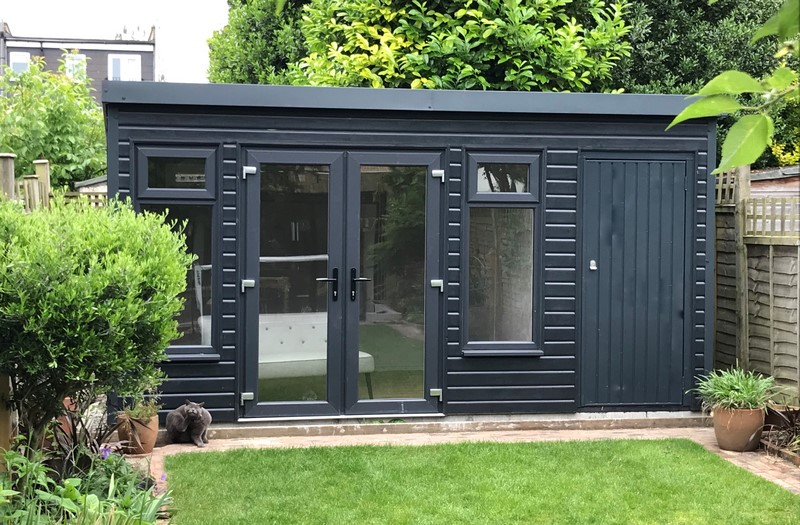 Pembroke Garden Room with Store finished in anthracite coloured paint with store room on the righthand side elevation