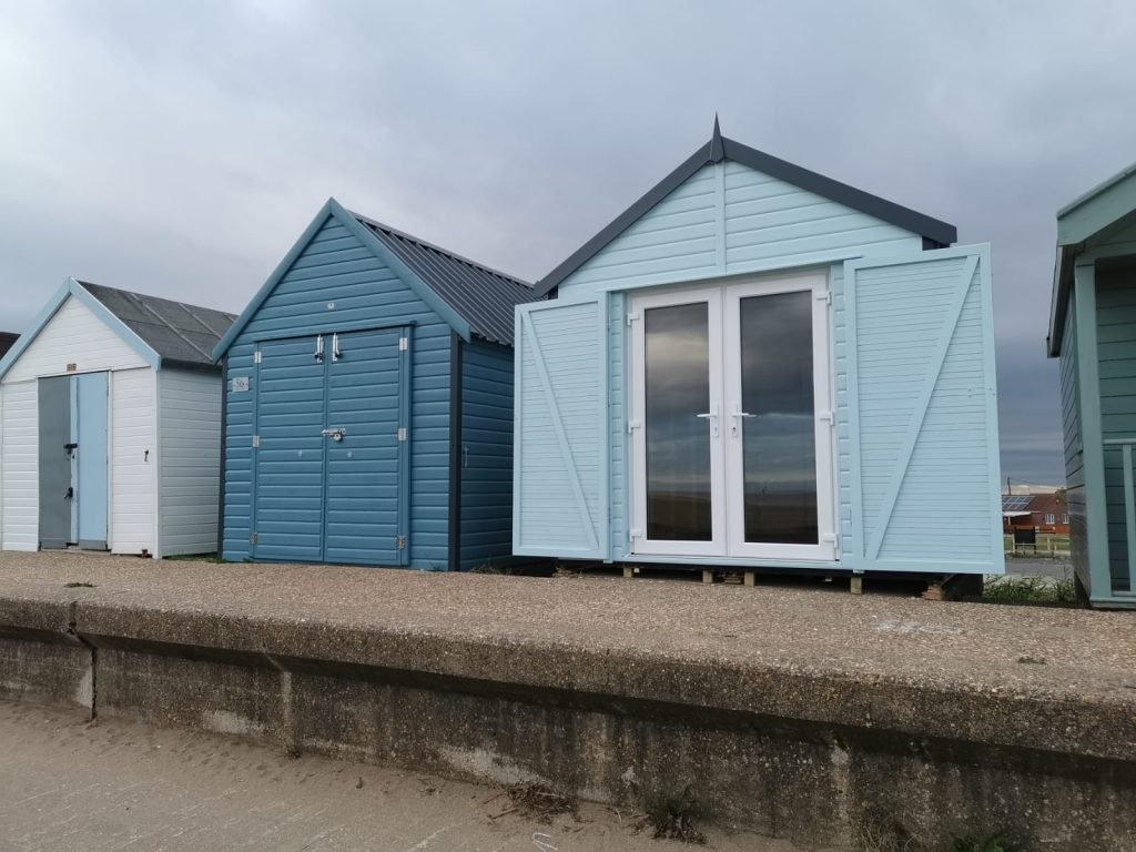 Beach Huts in heritage blue and eggshell blue