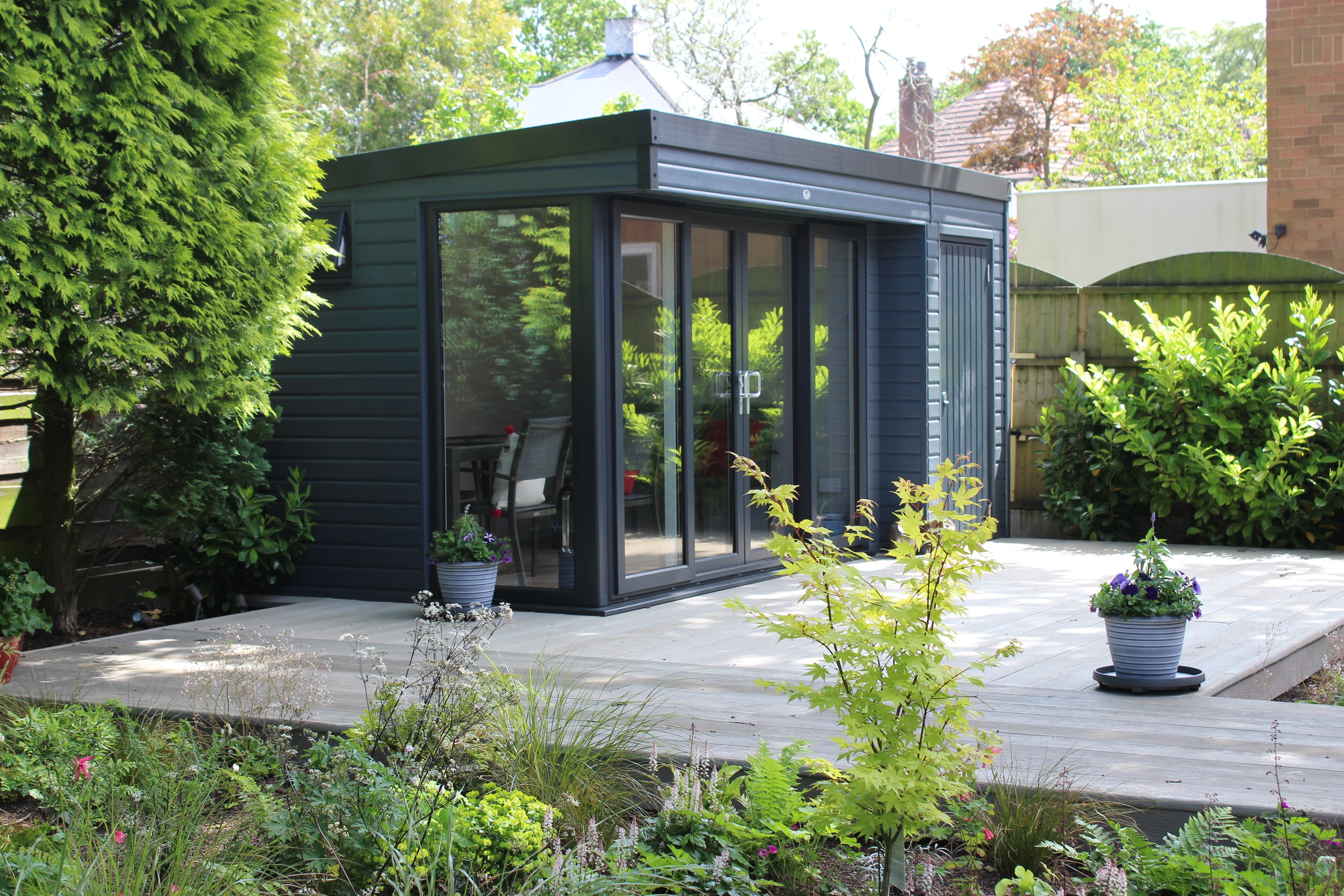 Garden Room with patio doors, fully insulated with a separate store room attached.