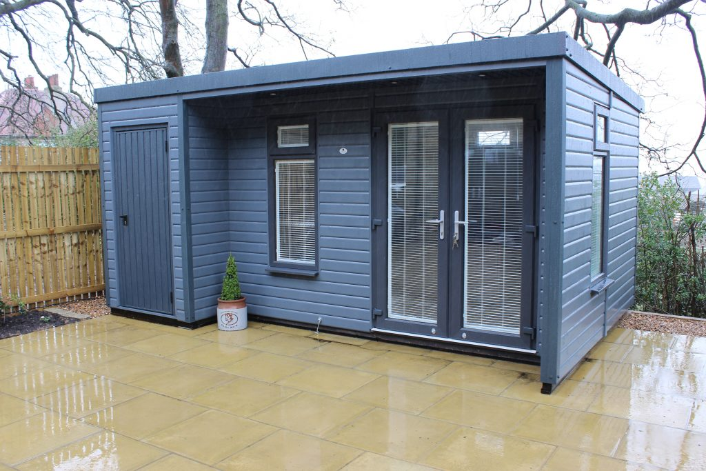 Garden Room with integrated storage including a canopy at the front finished in slate grey