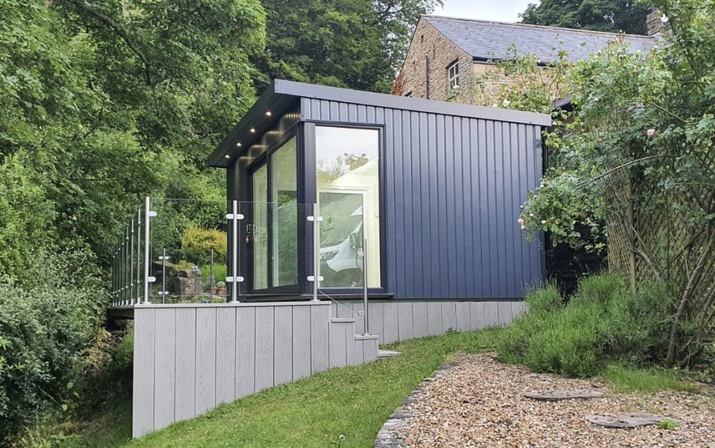 Manhattan slate grey garden room set onto grey composite decking