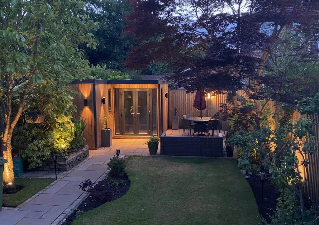 L shaped garden room finished in vertical timber cladding