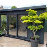 Manhattan garden Studio 4m wide x 3m deep in slate grey with optional garden view corner window.